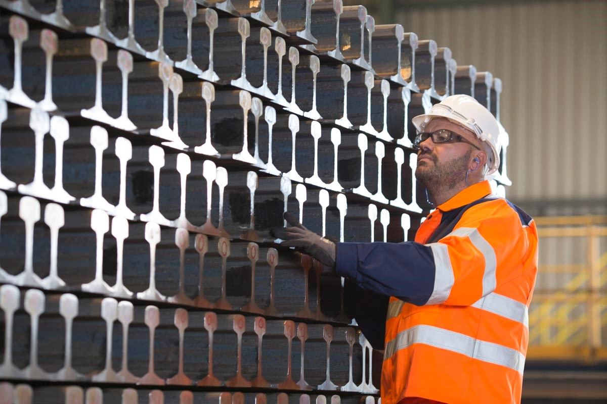 An inspector examining high speed vignole / flat bottomed rail being manufactured by British Steel.