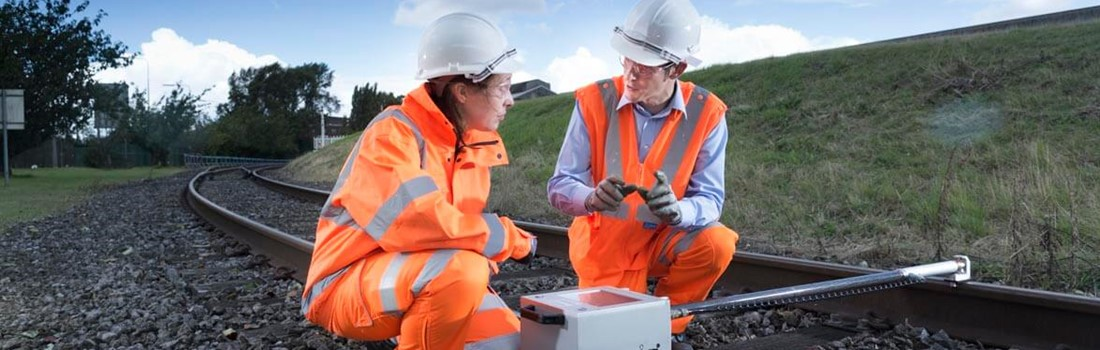 Rail experts using laser profile gauge to assess rail profile and calculate rail wear rates to predict asset life.