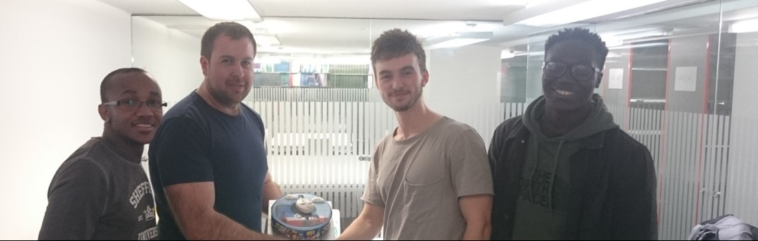 Stephen receiving his Thomas the Tank Engine cake to congratulate him on his new role in Rail Technologies.