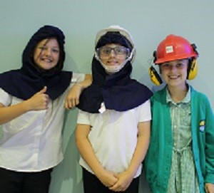 Pupils dress up as steelworkers during a visit to British Steel Scunthorpe site