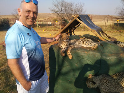 Colin stroking a Cheetah