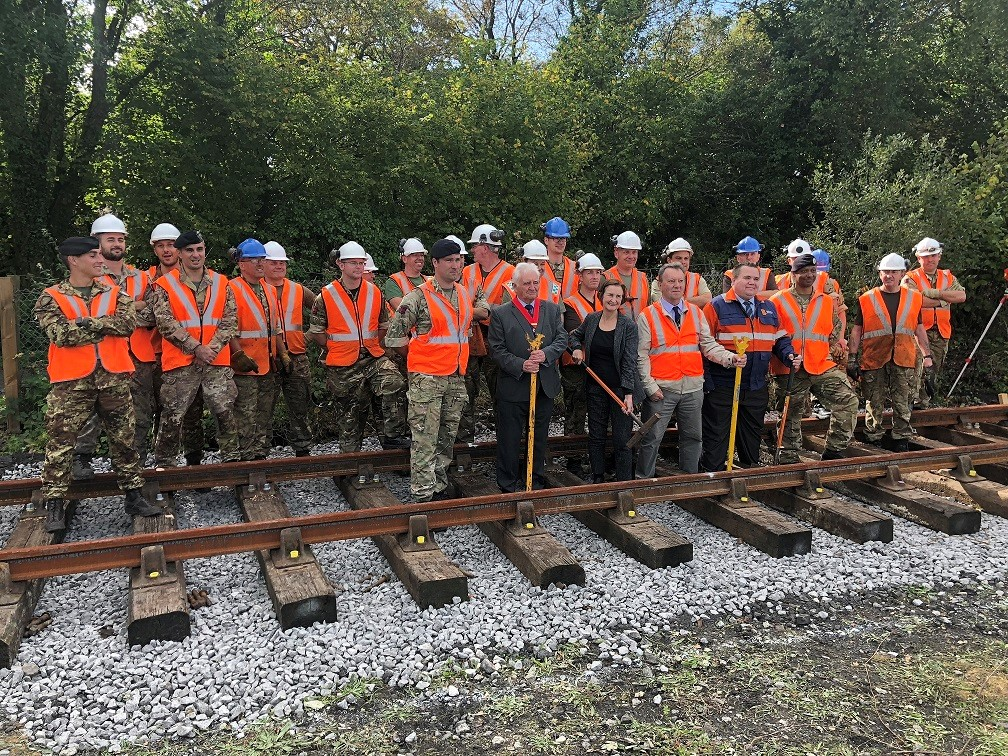 Soldiers and other members of the rail installation team stood on the track at Llanelli & Mynydd Mawr Railway