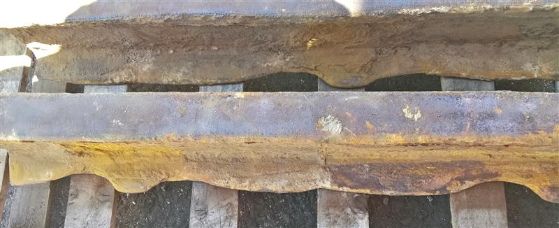 Severe rail corrosion hidden beneath a rail road crossing