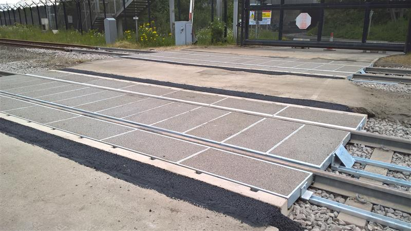 Zinoco corrosion protected rail road crossing