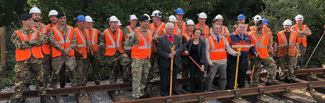 Royal Engineer soldiers, who helped install British Steel track, and dignitaries at the Llanelli & Mynyd Mawr Railway.
