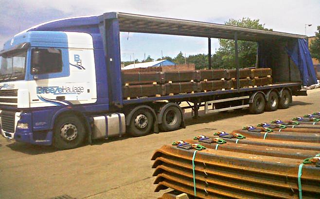 Stacks of British Steel sleepers loaded on rail transport lorry