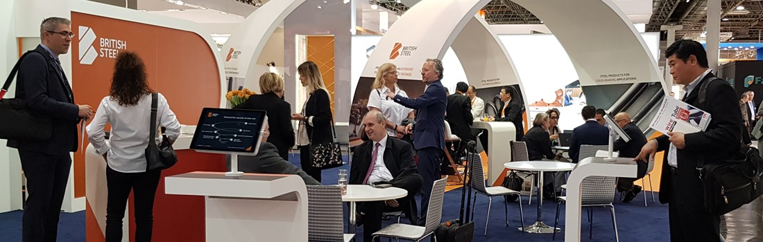 Customers meet with British Steel staff on the wire exhibition stand in Dusseldorf