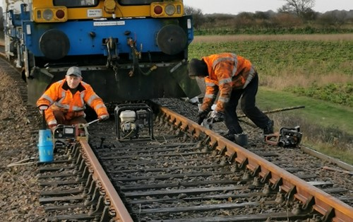 2 workers replacing the North Norfolk Railway track with bullhead rails from British Steel