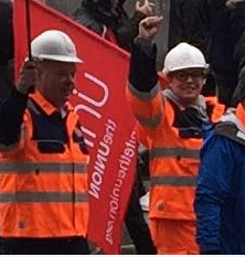 Employees marching in support of the steel industry.