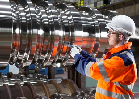 Employee inspecting steel product.