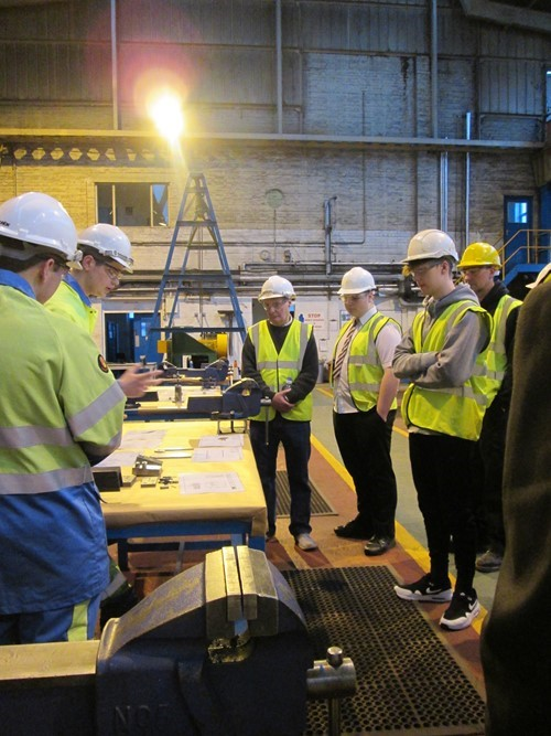 Apprentices learning about health and safety in the steel industry.